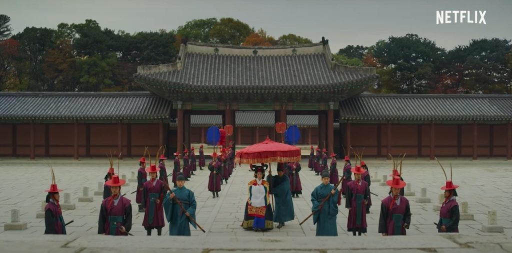 Queen Standing in Front of the Palace in Kingdom on Netflix